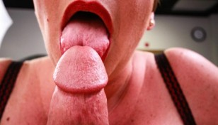 mature babe licking the tip of a cock