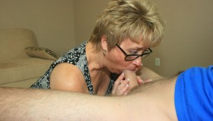 blonde MILF swallowing a big cock