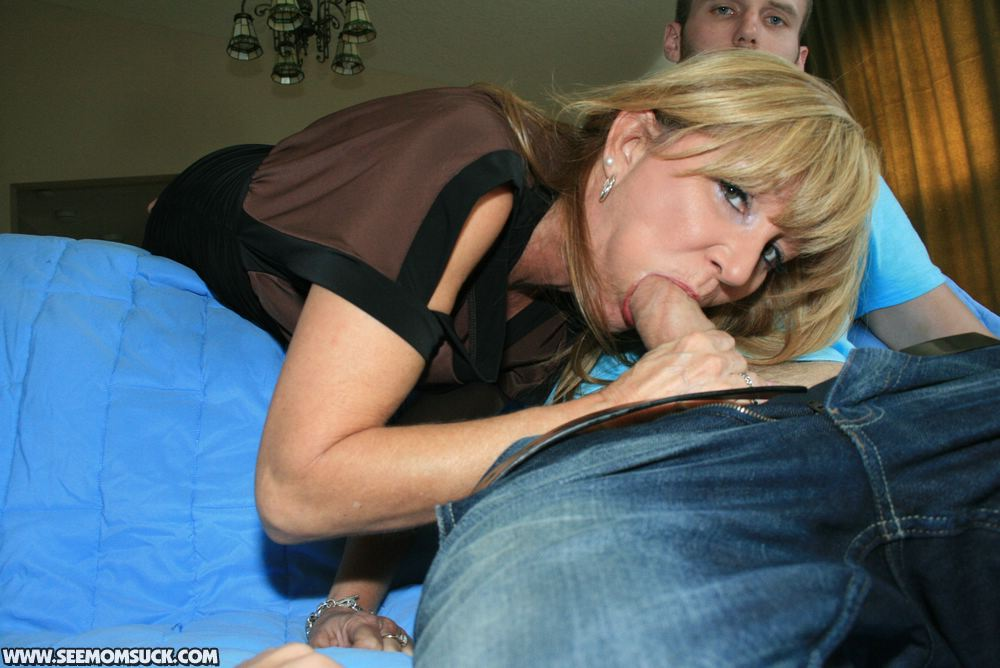 Older woman sucks and fucks younger man 1